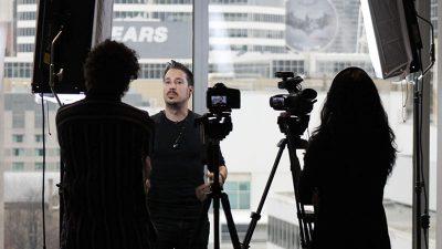 EK and Greg shooting an interview