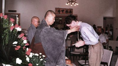 Greg taking Buddhist precepts in 1993